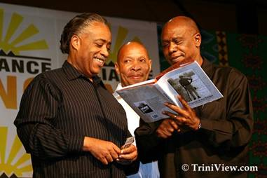 Al Sharpton is presented with a copy of Nelson Mandela's latest book 'A Prisoner in the Garden'